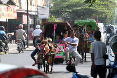 Gig. People enjoy traveling with tour gig in the city of Solo, Central Java, Indonesia royalty free stock photos