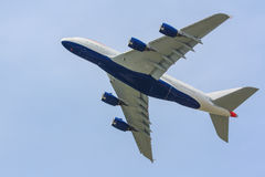 Gigantic airliner. Huge airplane taking to the skies, showing its underside and large wings Stock Photography