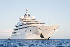 Gigantic big and large luxury mega or super motor yacht on the o Stock Photos