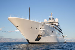 Gigantic big and large luxury mega or super motor yacht on the o. Gigantic big and large luxury mega or super motor yacht on the blue ocean stock images