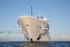 Gigantic big and large luxury mega or super motor yacht on the o. Gigantic big and large luxury mega or super motor yacht on the blue ocean stock photos