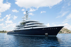 Gigantic big and large luxury mega yacht with helicopter landing Stock Photo