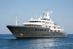 Gigantic big luxury mega or super motor yacht. Investment for mi. Gigantic big and large luxury mega or super motor yacht. Investment for millionaires or stock photography