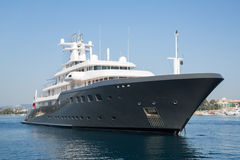 Gigantic big luxury mega or super motor yacht. Investment for mi. Gigantic big and large luxury mega or super motor yacht. Investment for millionaires or stock images
