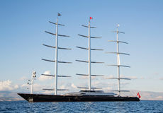 Gigantic big sailing boat or yacht in the blue sea. Royalty Free Stock Image