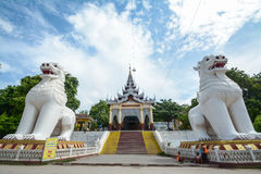 Gigantic Bobyoki Nat guardian statues at central entrance gate to Mandalay Hill Pagoda complex. Amazing architecture of Buddhist T Royalty Free Stock Image