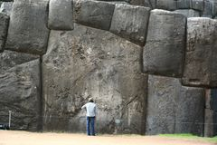The gigantic boulder of Sacsayhuaman show the scale of it with human being. It perfectly fitted together with other stones. This i stock photos