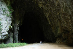 Gigantic cave mouth. Person standing in a mouth of a huge cave in Skocjan, Slovenia Royalty Free Stock Photography