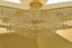 Gigantic chandelier in Abdul Fahem Mosque. The pictures show a big modern chandelier in copper and crystal design hanging on the ceiling of the Abdullah Fahem Royalty Free Stock Photo