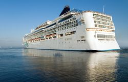 Gigantic cruise vessel leaves seaport Stock Photo
