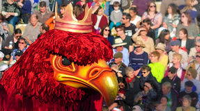 A gigantic eagle at the Carnival in Nice. This red eagle parades wearing a crown over its head in celebration during the Nice Festival cheered by a crowd Stock Image