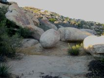 Sphere and egg shaped giant boulders at Lizard`s Mouth trail. Gigantic egg and sphere shaped boulders of sandstone sitting at Lizard`s Mouth Rock, Santa Barbara Royalty Free Stock Photo