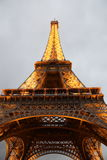 Gigantic Eiffel Tower. A shot of the Impressive Eiffel Tower from Below under a cloudy sky at sunset Stock Photo
