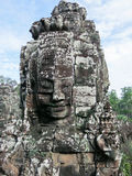 Gigantic face in Angkor  Thom. Gigantic face in Angkor Thom with blue sky Stock Photos