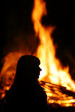 The gigantic fire. A girl stands before a gigantic fire Royalty Free Stock Images