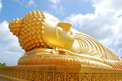 Gigantic golden Buddha in Thai temple Stock Photos