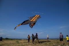 Gigantic Kite Bali. Sanur, Bali, Indonesia - July 19, 2015: A group of people is starting a gigantic kite at Sanur Beach stock photos
