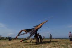 Gigantic Kite Bali. Sanur, Bali, Indonesia - July 19, 2015: A group of people is starting a gigantic kite at Sanur Beach royalty free stock image