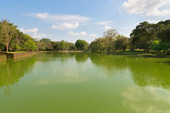 Gigantic man made pond in tropical forest Stock Images