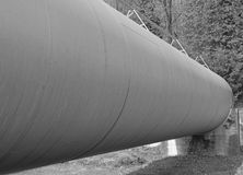 Gigantic pipeline for the transport of flammable liquid between Royalty Free Stock Photography
