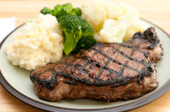 A gigantic rib steak fresh from the grill Stock Images