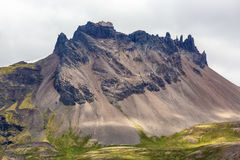 Gigantic rock in Iceland. View of huge rock of icelandic mountains Royalty Free Stock Photography