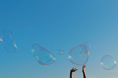 Gigantic soap bubble toy with blue sky background. The gigantic soap bubble toy with blue sky background Stock Images