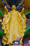 Gigantic Standing Buddha in Tambun Tibetian Buddhist Temple, Perak. Tambun Tibetian Temple, also known as Jingang Jing She by the locals, is surrounded by Royalty Free Stock Image