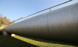 Gigantic steel pipe for the transport of gases or petroleum unde. Very long steel pipe for the transport of gases or oil under construction Royalty Free Stock Photos