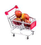 Gigantic sugar plums in shopping cart Stock Photo