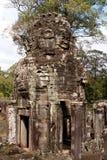 Gigantische Gesichts-Statuen am Khmer-Tempel Stockfotografie