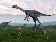Gigantoraptor e piccoli dinosauri di mononykus - 3D Fotografia Stock