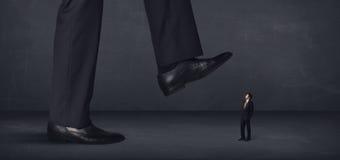 Gigantyczny osoby kroczenie na biznesmena pojęciu troszkę Obraz Royalty Free