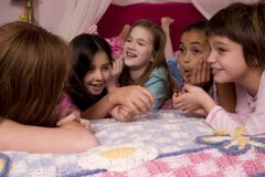 Giggles. Five adorable girls laughing and giggling at a slumber party Stock Photography