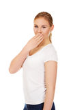 Giggles young woman covering her mouth with hand Stock Photo