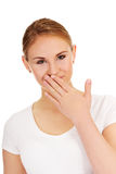 Giggles young woman covering her mouth with hand.  Royalty Free Stock Photo