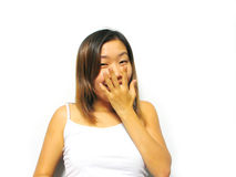 Giggling. Asian girl laughing royalty free stock image