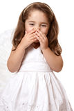 Giggling angel or fairy. Adorable giggling angel girl wearing a white dress and angel wings Stock Photos