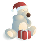 Giggling bear with a gift. Giggling bear with a red gift box Royalty Free Stock Image