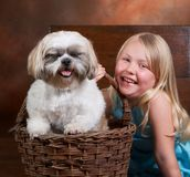 Giggling doggy. Little blond girl and her dog, both with a big smile Stock Photos