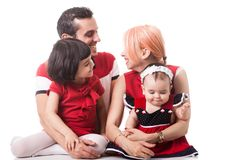 Giggling happy family of four members over white background Stock Photos