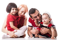 Giggling happy family of four members over white background Stock Image