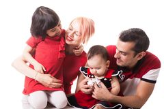 Giggling happy family of four members over white background Royalty Free Stock Image