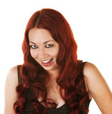 Giggling Hispanic Woman. Giggling Mexican woman with curly red hair Stock Photos