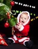 Giggling Santa baby Royalty Free Stock Images
