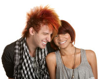 Giggling Teenage Couple. Giggling young teenage couple over white background Stock Photos