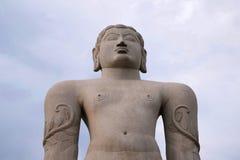 A gigiantic monolithic statue of Bahubali, also known as Gomateshwara, Vindhyagiri Hill, Shravanbelgola, Karnataka. View from the. A gigiantic monolithic statue stock photo
