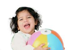 Gigl feliz con una bola Imagen de archivo libre de regalías