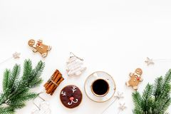 Gignerbread cookies for New Year 2019. Gingerbread man and cookies in shape of heart and new year spruce near cinnamon royalty free stock images