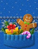 Gigngerbread人,礼物,棒棒糖,在kn的分支 库存照片